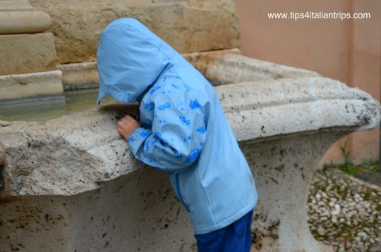 Spoleto looking for treasures in a fountain